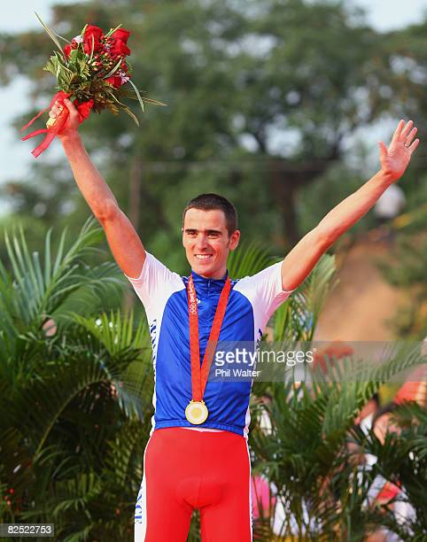 Gold medalist Julien Absalon of France celebrates victory on the podium during the medal ceremony for the Men's Cross Country mountain bike cycling...