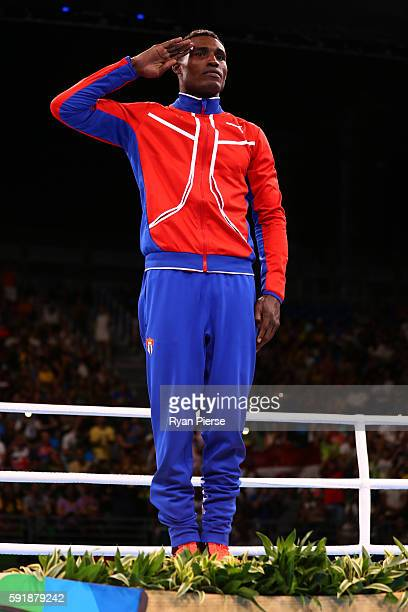 Gold medalist Julio Cesar La Cruz of Cuba stands on the podium during the medal ceremony for the Men's Light Heavy Boxing event on Day 13 of the 2016...