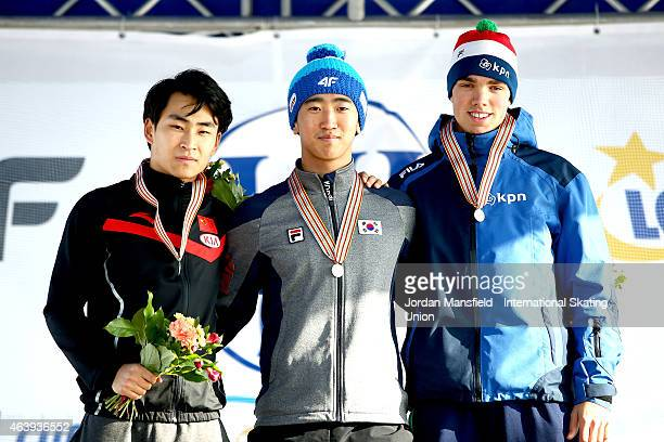Gold medalist JunHo Kim of Korea Silver medalist Fan Yang of China and Bronze medalist Patrick Roest of the Netherlands pose for a picture after...