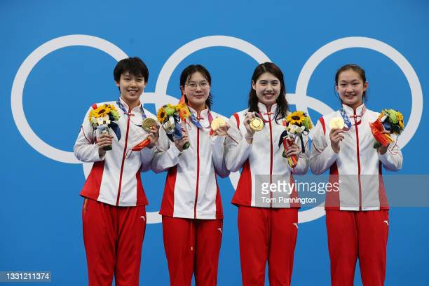 Gold medalist Junxuan Yang, Yufei Zhang, Bingjie Li and Muhan Tang of Team China poses with the gold medal for the Women's 4 x 200m Freestyle Relay...