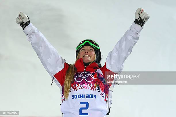 Gold medalist Justine DufourLapointe of Canada celebrates on the podium during the flower ceremony following the Ladies' Moguls Final 3 on day one of...