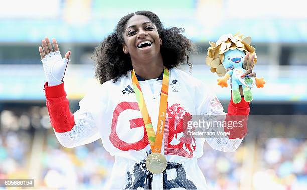 Gold medalist Kadeena Cox of Great Britain celebrates on the podium at the medal ceremony for the Women's 400m T38 on day 7 of the Rio 2016...