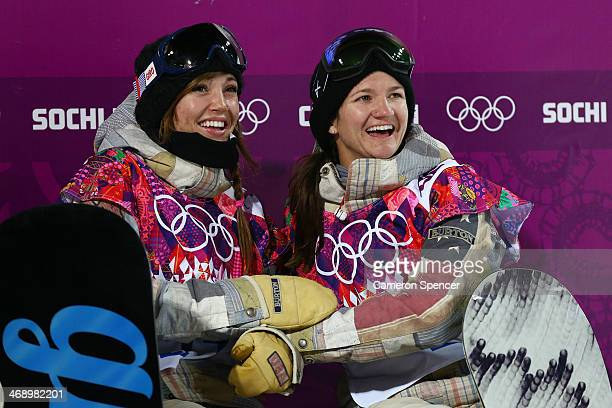 Gold medalist Kaitlyn Farrington of the United States and Bronze medalist Kelly Clark of the United States celebrate after the Snowboard Women's...