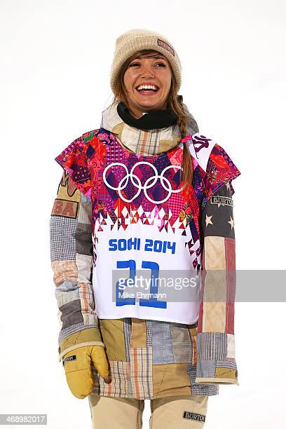 Gold medalist Kaitlyn Farrington of the United States celebrates during the flower ceremony for the Snowboard Women's Halfpipe Finals on day five of...