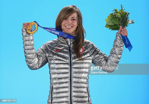 Gold medalist Kaitlyn Farrington of the United States celebrates during the medal ceremony for the Snowboard Ladies' Halfpipe on day six of the Sochi...