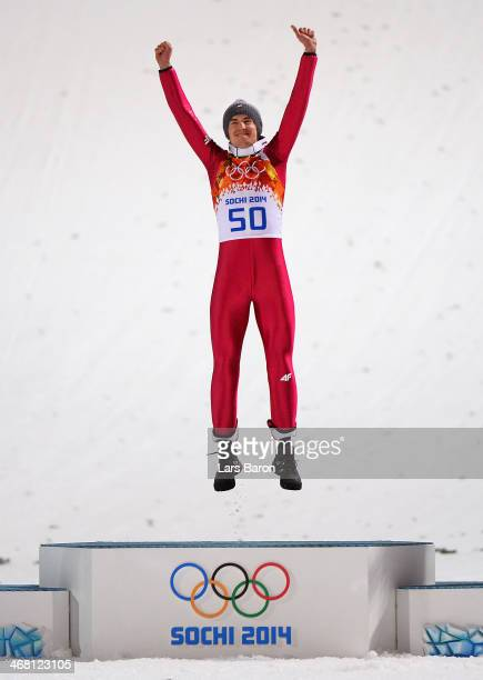 Gold medalist Kamil Stoch of Poland celebrates during the flower ceremony for the Men's Normal Hill Individual Final on day 2 of the Sochi 2014...