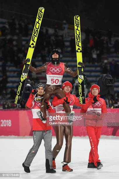 Gold medalist, Kamil Stoch of Poland is lifted in the air as he celebrates following the Ski Jumping - Men's Large Hill on day eight of the...