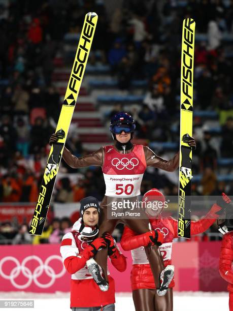 Gold medalist Kamil Stoch of Poland is lifted in the air as he celebrates following the Ski Jumping Men's Large Hill on day eight of the PyeongChang...
