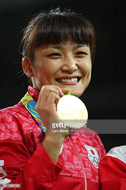 Gold medalist Kaori Icho of Japan celebrates during the medal ceremony after the Women's Freestyle 58 kg competition on Day 12 of the Rio 2016...