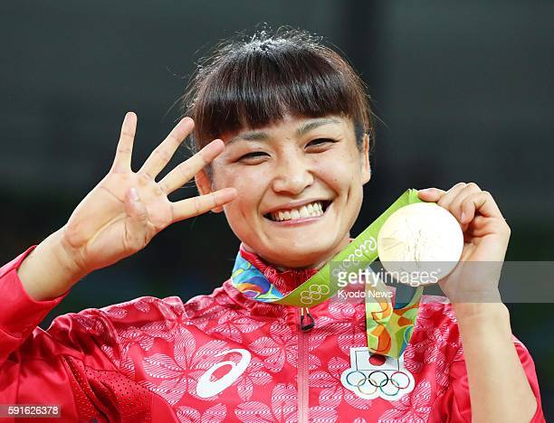 Gold medalist Kaori Icho of Japan smiles during the award ceremony for the women's freestyle wrestling 58kilogram class at the Rio de Janeiro...