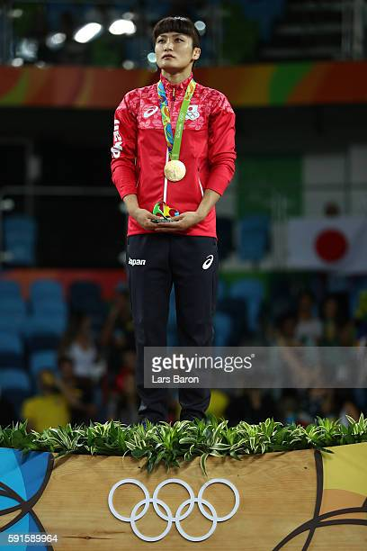 Gold medalist Kaori Icho of Japan stands on the podium during the medal ceremony after the Women's Freestyle 58 kg competition on Day 12 of the Rio...