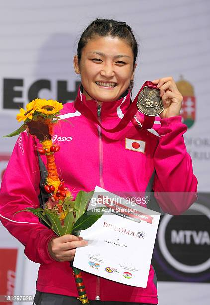 Gold medalist Kaori Icho poses for photographs on the podium after winning the Women's 63kg Freestyle day four of the FILA Wrestling World...