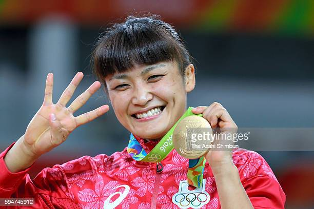 Gold medalist Kaori Icho poses for photographs on the podium at the medal ceremony for the Women's Wrestling 58kg on Day 12 of the Rio 2016 Olympic...