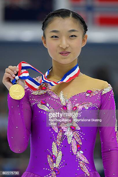Gold medalist Kaori Sakamoto of Japan poses for photographs on the podium after the medal ceremony during the ISU Junior Grand Prix of Figure Skating...