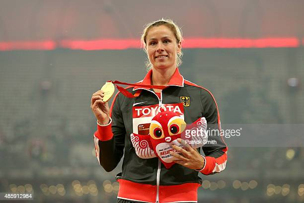 Gold medalist Kathrina Molitor of Germany poses on the podium during the medal ceremony for the Women's Javelin final during day nine of the 15th...