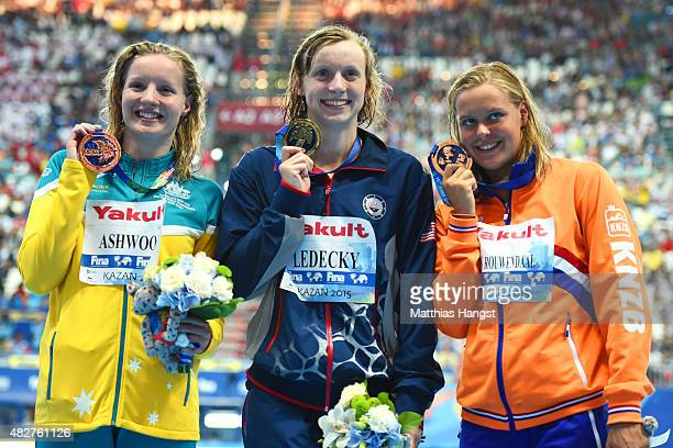 Gold medalist Katie Ledecky of the United States poses with silver medalist Sharon van Rouwendaal of the Netherlands and bronze medalists Jess...