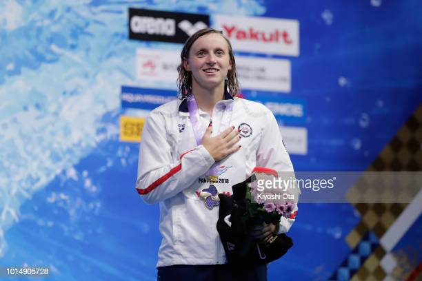 Gold medalist Katie Ledecky of the United States stands on the podium for the national anthem at the medal ceremony for the Women's 400m Freestyle on...
