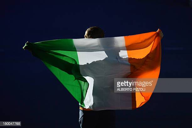 Gold medalist Katie Taylor of Ireland celebrates with her national flag after the podium of the women's boxing Lightweight of the 2012 London Olympic...