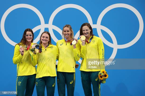 Gold medalist Kaylee McKeown, Chelsea Hodges Emma McKeon and Cate Campbell of Team Australia pose on the podium during the medal ceremony for the...