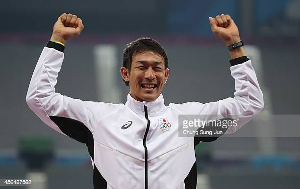 Gold medalist Keisuke Ushiro of Japan celebrates after winning the Men's Decathlon 1500m Final on day twelve of the 2014 Asian Games at Incheon Asiad...