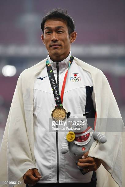 Gold medalist Keisuke Ushiro of Japan celebrates on the podium during the victory ceremony of the Men's Decathlon on day nine of the Asian Games on...