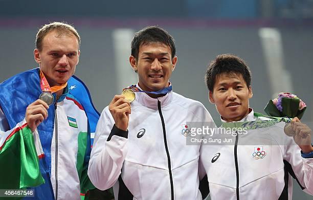 Gold medalist Keisuke Ushiro of Japan , Silver medalist Leonid Andreev of Uzbekistan and Bronze medalist Akihiro Nakamura of Japan pose during the...