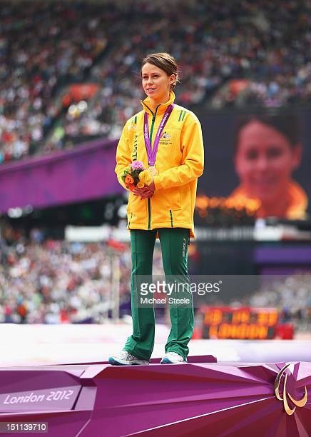 Gold medalist Kelly Cartwright of Australia poses on the podium during the medal ceremony for the Women's Long Jump F42/44 Final on day 4 of the...