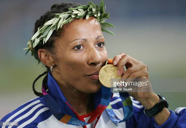 Gold medalist Kelly Holmes of Great Britain celebrates on the podium during the medal ceremony of the women's 800 metre event on August 23 2004...