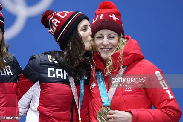 Gold medalist Kelsey Serwa of Canada and bronze medalist Fanny Smith of Switzerland celebrate during the medal ceremony for Freestyle Skiing Ladies'...