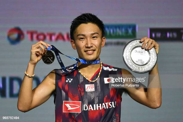 Gold medalist Kento Momota of Japan celebrates on the podium after winning the Men's Singles Final match on day six of the Blibli Indonesia Open at...
