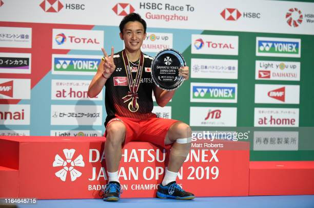 Gold medalist Kento Momota of Japan poses during the medal ceremony of the Men's Singles Final after defeating Jonatan Christie of Indonesia on day...