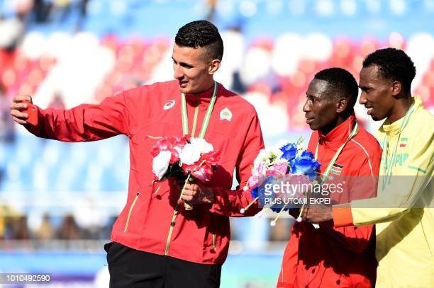 Gold medalist Kenya's Conseslus Kipruto silver medalist Morocco's Bakkali Soufiane and bronze medalist Ethiopia's Getnet Wale Bayabl pose for a...
