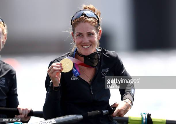 Gold medalist Kerri Gowler of Team New Zealand poses with her medal in her boat after the Women's Pair Final A on day six of the Tokyo 2020 Olympic...