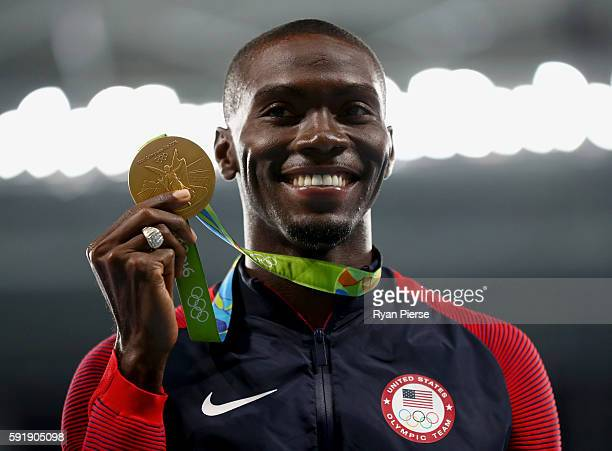 Gold medalist Kerron Clement of the United States poses on the podium during the medal ceremony for the Men's 400m Hurdles on Day 13 of the Rio 2016...