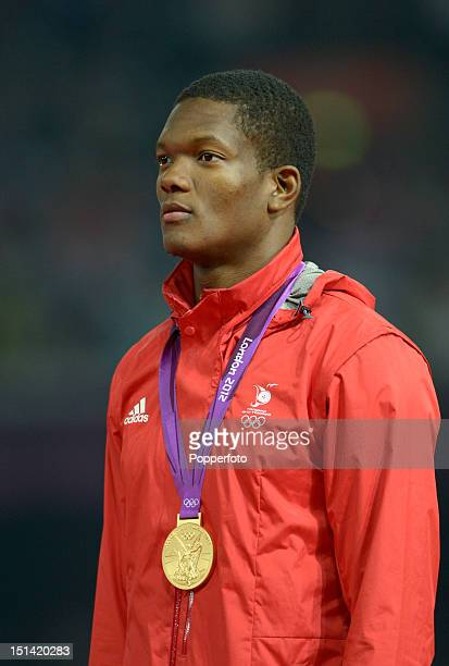 Gold medalist Keshorn Walcott of Trinidad and Tobago poses on the podium during the medal ceremony for the Men's Javelin Throw on Day 15 of the...