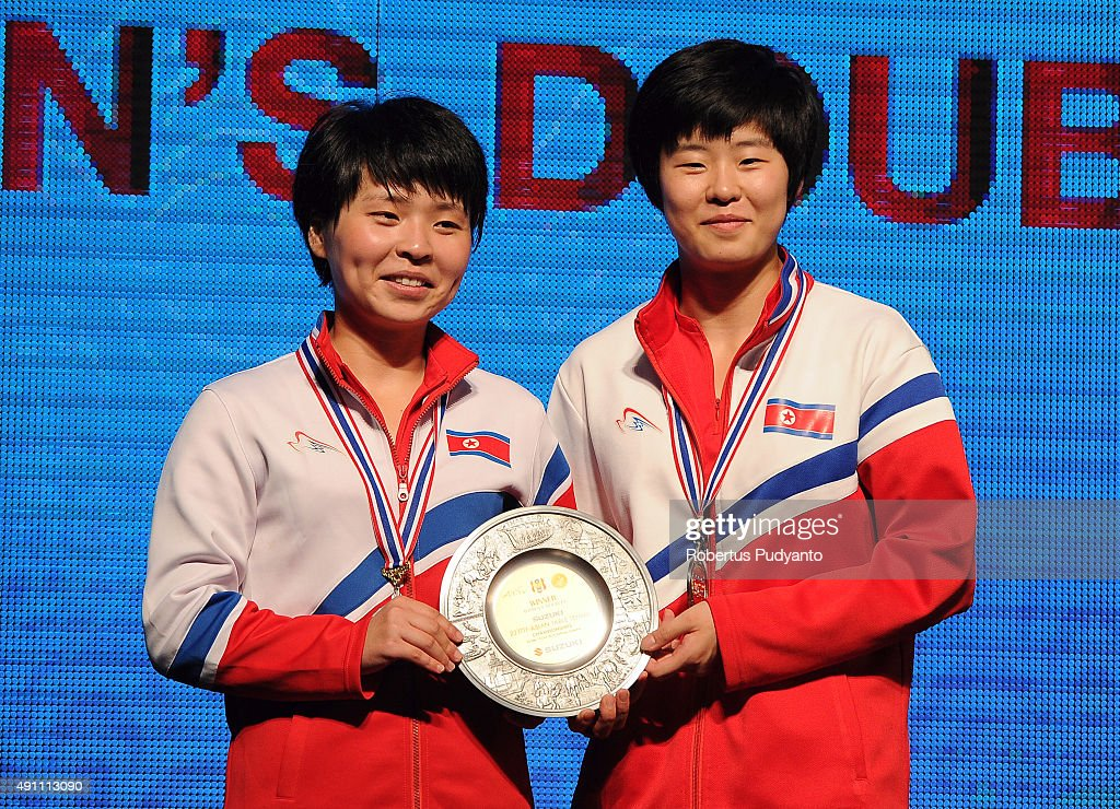 Gold medalist Kim Hye Song and Ri Mi Gyong of DPR Korea celebrate on the podium during Women's doubles awarding ceremony of the 22nd 2015 ITTF Asian Table Tennis Championships at Pattaya Sports Indoor Stadium on October 3, 2015 in Pattaya, Thailand.