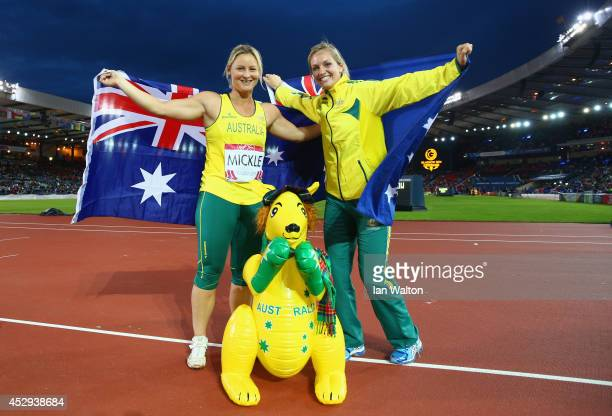 Gold medalist Kim Mickle of Australia and Kelsey-Lee Roberts of Australia celebrate after the Women's Javelin final at Hampden Park during day seven...