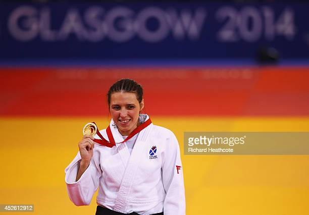 Gold medalist Kimberley Renicks of Scotland celebrates on the podium during the medal ceremony for the Women's -48kg Gold medal contest at the at...