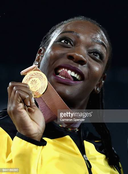 Gold medalist Kimberly Williams of Jamaica celebrates during the medal ceremony for the Women's Triple Jump during the Athletics on day six of the...