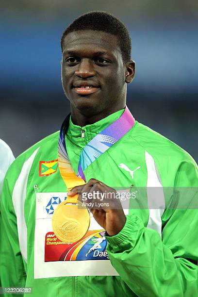 Gold medalist Kirani James of Grenada celebrates on the podium with his medal for the men's 400 metres during day six of 13th IAAF World Athletics...