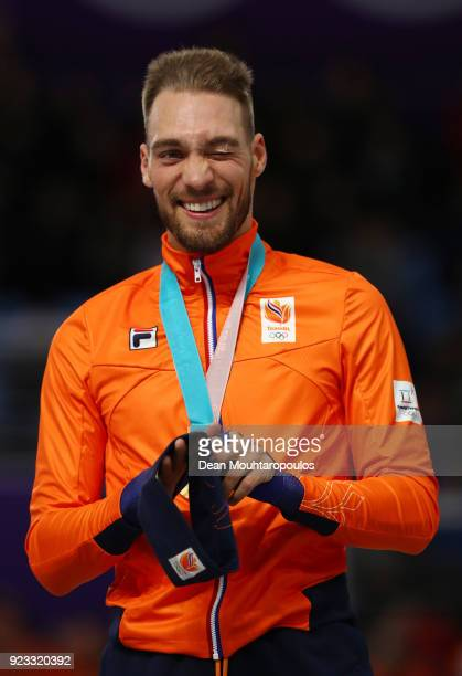 Gold medalist Kjeld Nuis of the Netherlands celebrates during the medal ceremony after the Speed Skating Men's 1000m on day 14 of the PyeongChang...