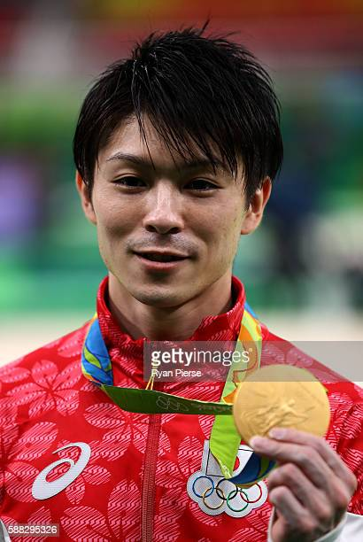 Gold medalist Kohei Uchimura of Japan poses for photographs after the medal ceremony for the Men's Individual AllAround on Day 5 of the Rio 2016...