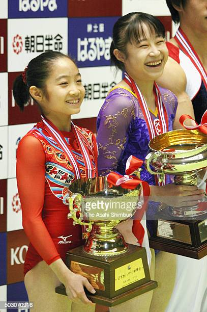 Gold medalist Koko Tsurumi and silver medalist Miki Uemura smile on the podium at the medal ceremony for the Women's AllAround during day two of the...