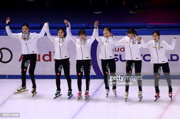 Gold medalist Korean team celebrate their victory after the final competition in the 'Women 3000m Relay' category at the ISU World Cup Short Track in...