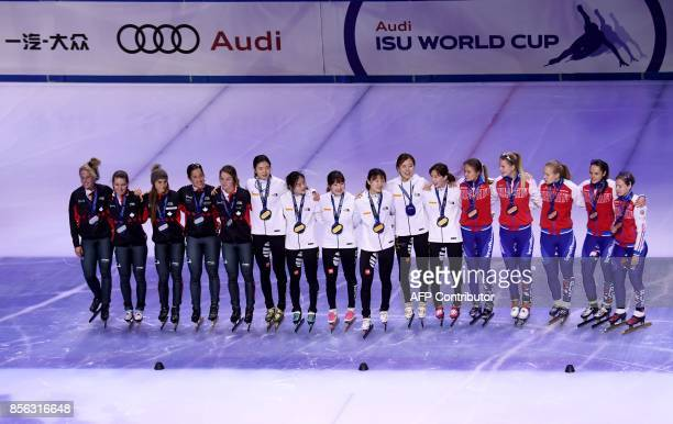 Gold medalist Korean team celebrate their victory with second placed Canada and bronze medalist Russia after the final competition in the 'Women...