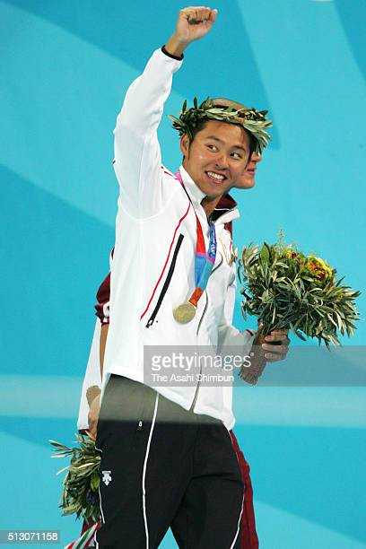 Gold medalist Kosuke Kitajima of Japan celebrates after the medal ceremony for the Swimming men's 200m Breaststroke at the Olympic Aquatic Centre...