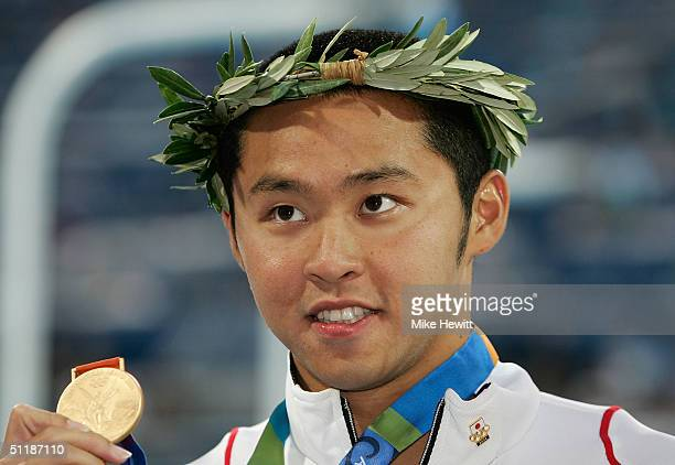 Gold medalist Kosuke Kitajima of Japan celebrates on the podium during the medal ceremony of the men's swimming 200 metre breaststroke event on...