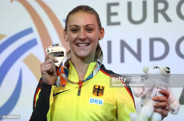 Gold medalist Kristin Gierisch of Germany poses during the medal ceremony for the Women's Triple Jump on day two of the 2017 European Athletics...