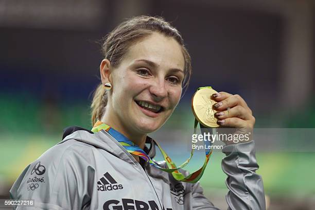 Gold medalist Kristina Vogel of Germany celebrates during the medal ceremony after the Women's Sprint Finals race on Day 11 of the Rio 2016 Olympic...