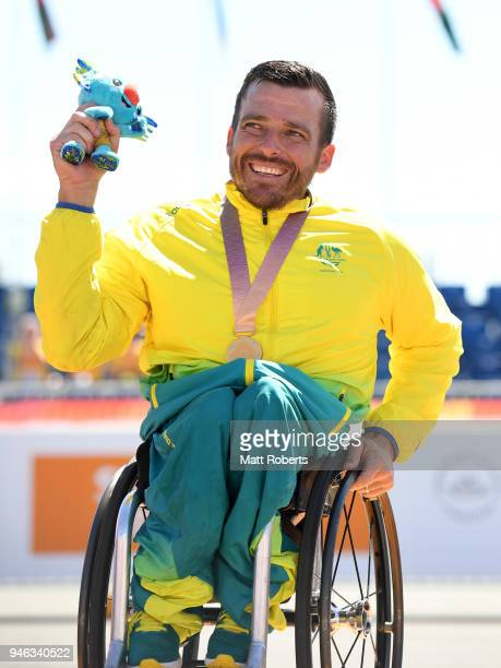Gold medalist Kurt Fearnley of Australia celebrates during the medal ceremony for the Men's T54 marathon on day 11 of the Gold Coast 2018...
